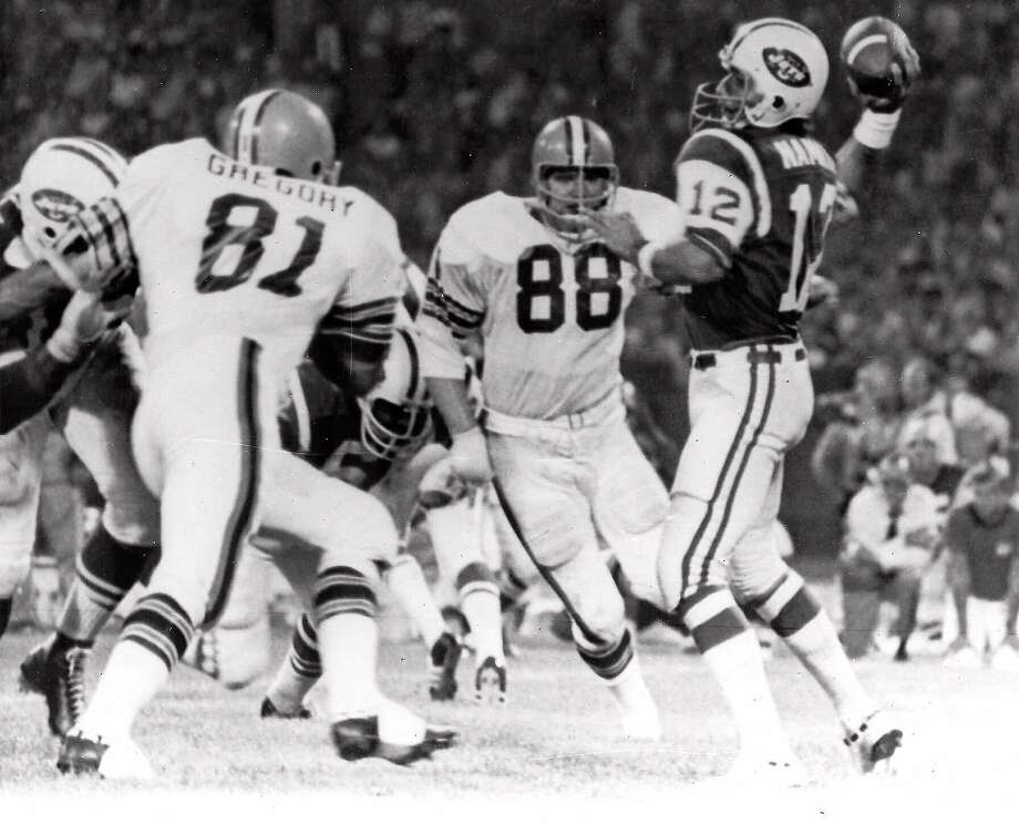"Browns defensive ends Jack Gregory (81) and Ron Snidow (88) blast through the Jets protection to pressure Joe Namath in the first ""Monday Night Football"" game on Sept. 21, 1070. Photo: Associated Press 1970"