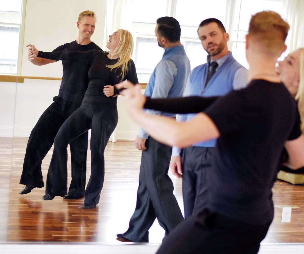 Dancing with the Stars champion Tony Dovolani watches as Astaire studio co-owner Elmar Schmidt and Greenwich actress Afton Fraser practice their routine for the upcoming Dancing Stars of Greenwich charity dance-off gala for Abilis at Fred Astaire Dance Studio in Greenwich, Conn. Tuesday, Sept. 10, 2019. Dancing with the Stars champion Tony Dovolani was on hand to help dancers with their choreography during Tuesday's practice session. The Dancing Stars of Greenwich event will be held at Tamarack Country Club on Saturday, Sept. 14 at 7 p.m. to benefit local special needs nonprofit Abilis. The event pairs local celebrities in choreographed dance routines with instructors from the Astaire studio to be judged by actor Brendan Fraser, news anchor Lara Spencer, and Dancing with the Stars champion Tony Dovolani.