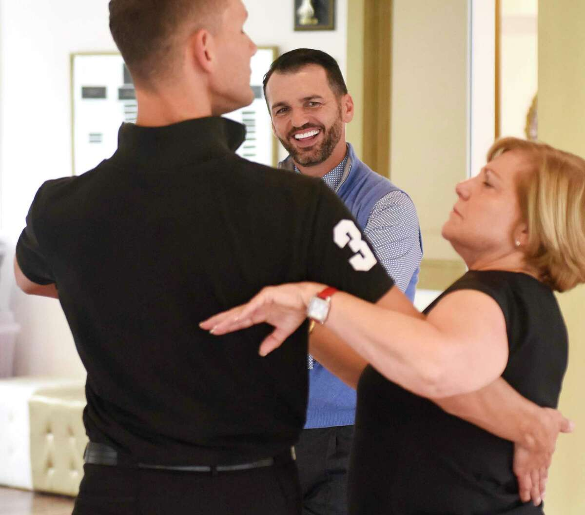 Dancing with the Stars champion Tony Dovolani watches as Astaire studio co-owner Clemens Lengenfelder and Greenwich resident Elaine Madonna practice their routine for the upcoming Dancing Stars of Greenwich charity dance-off gala for Abilis at Fred Astaire Dance Studio in Greenwich, Conn. Tuesday, Sept. 10, 2019. Dancing with the Stars champion Tony Dovolani was on hand to help dancers with their choreography during Tuesday's practice session. The Dancing Stars of Greenwich event will be held at Tamarack Country Club on Saturday, Sept. 14 at 7 p.m. to benefit local special needs nonprofit Abilis. The event pairs local celebrities in choreographed dance routines with instructors from the Astaire studio to be judged by actor Brendan Fraser, news anchor Lara Spencer, and Dancing with the Stars champion Tony Dovolani.