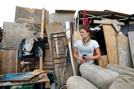Jamie Dong stands outside the makeshift structure she lives in along San Leandro Avenue on Friday, September 6, 2019 in Oakland, CA. Oakland Public Works Department is requiring structures in a homeless encampment along San Leandro Avenue to be dissembled and removed by September 11, 2019 when the encampment will be temporarily closed for a full cleaning. Photo: Lea Suzuki / The Chronicle
