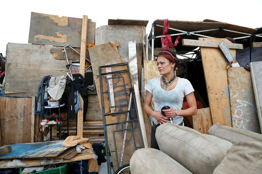 Jamie Dong stands outside the makeshift structure she lives in along San Leandro Avenue in Oakland, CA. Photo: Lea Suzuki / The Chronicle