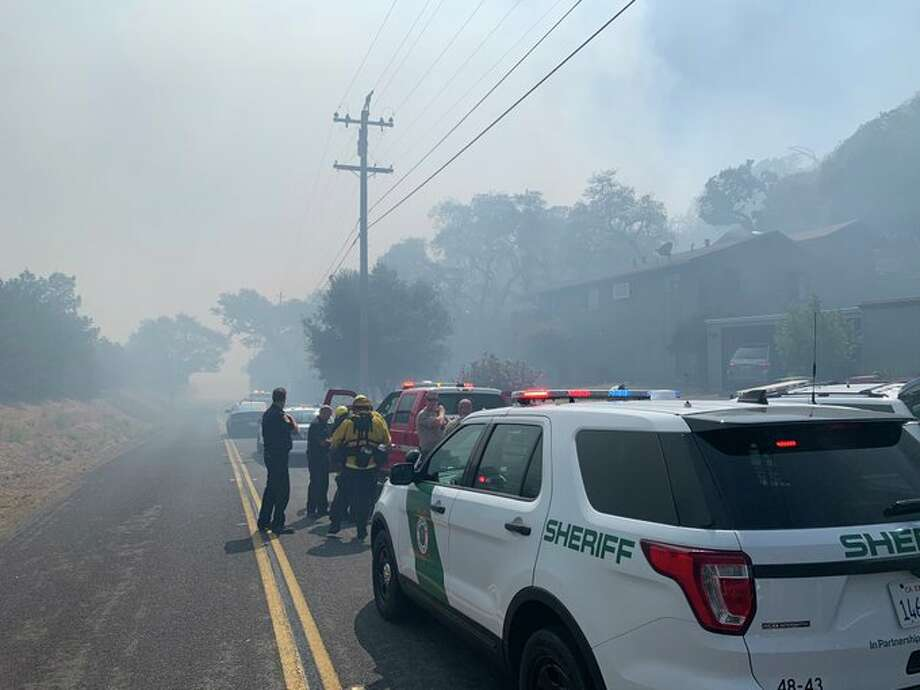 A vegetation fire in Novato is threatening structures and prompted evacuation orders on Tuesday, according tot he Marin County Fire Department. Photo: Courtesy Of The Marin County Sheriff's Department