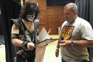 """Chief Lynch and Eric Singer of KISS reading his honorary appointment letter as a member of our Police Department."""