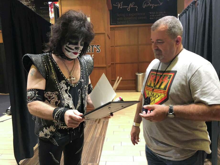 """Chief Lynch and Eric Singer of KISS reading his honorary appointment letter as a member of our Police Department."" Photo: Wharton PD/Facebook"