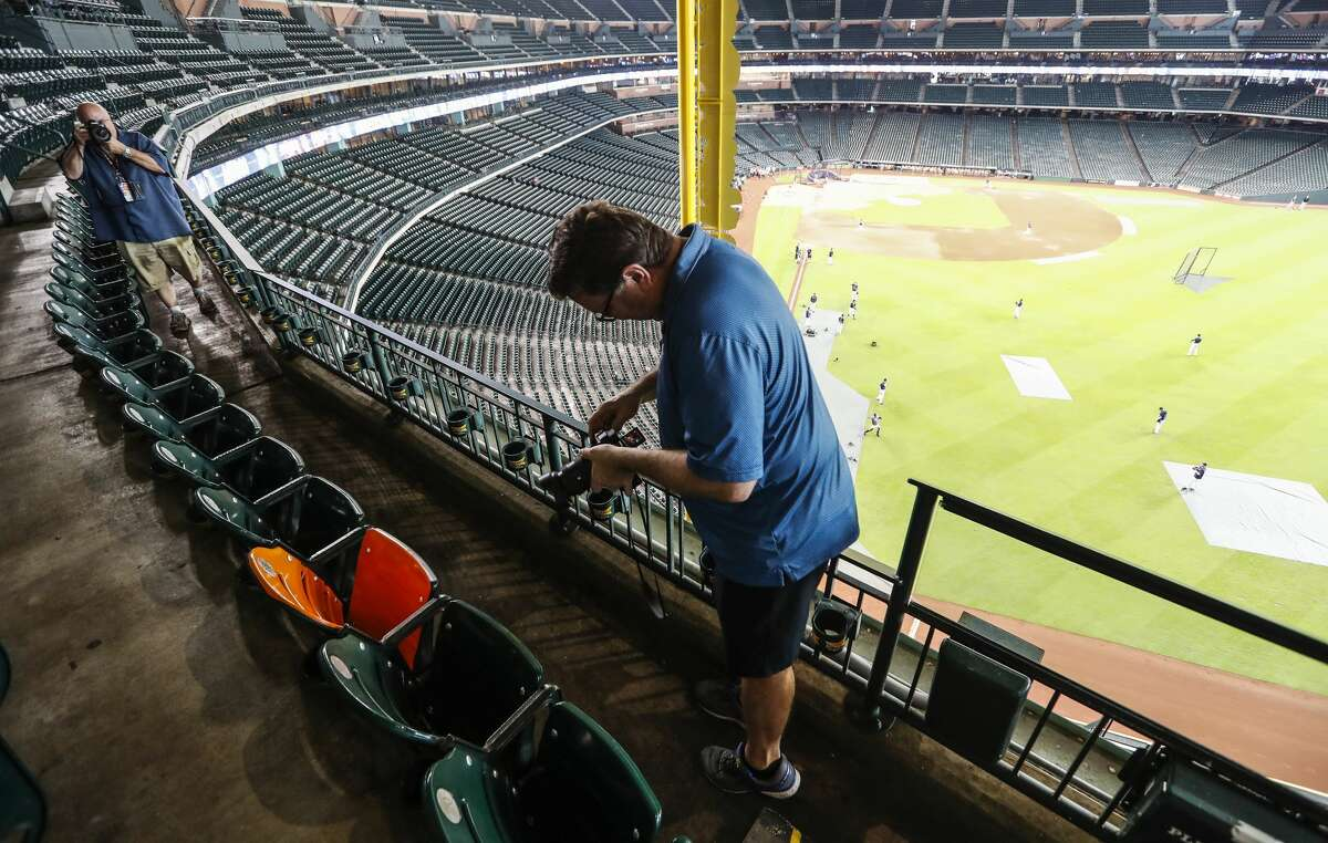 Associated Press photographer David Phillip takes a photo of the seat that Yordan Alvarez' upper deck home run landed in last night has been wrapped in orange vinyl by the Astros to mark it. The location is section 337, Row 1, Seat 18. Alvarez is the first Astros player ever to reach the third deck in right field of Minute Maid Park, Tuesday, Sept. 10, 2019, in Houston.