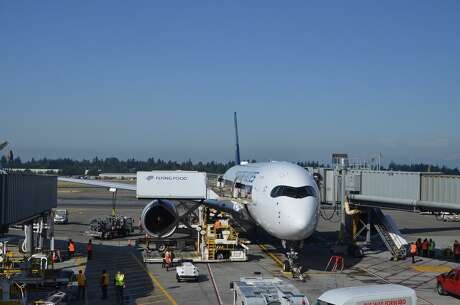 The Singapore Airlines A350-900XWB gets catered before its return flight from Seattle-Tacoma International Airport to Singapore's Changi Airport.
