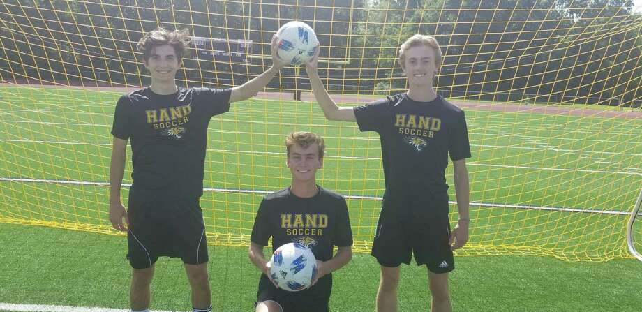 From left, Hand boys soccer captains Spencer Hartmann, Cole Finke and Jack Green. The Tigers are the three-time reigning Class L state champions. Photo: Joe Morelli / Hearst Connecticut Media