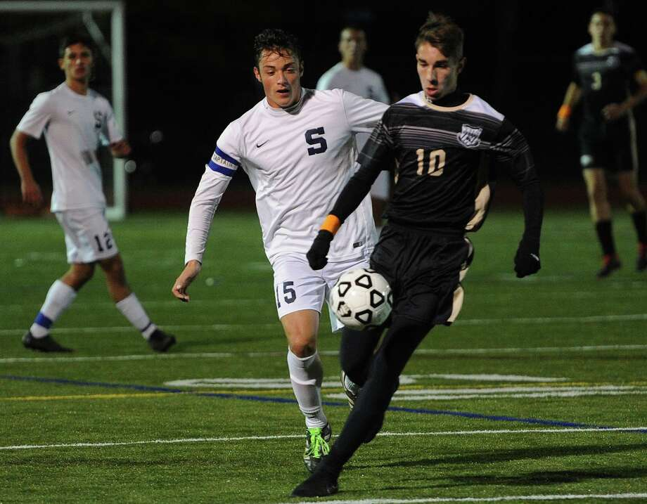 Staples' Gabriel Baltierra, left, converges on the ball with Trumbull's Tiago Frazao during the first half of their FCIAC boys soccer semifinal game. Photo: Brian A. Pounds / Hearst Connecticut Media / Connecticut Post