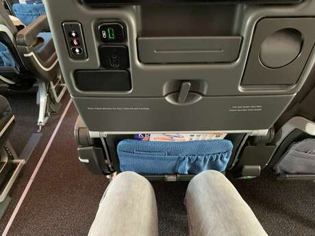 In addition to the respectable legroom, fliers in economy class also get a foot rest.  Photo: Tim Jue