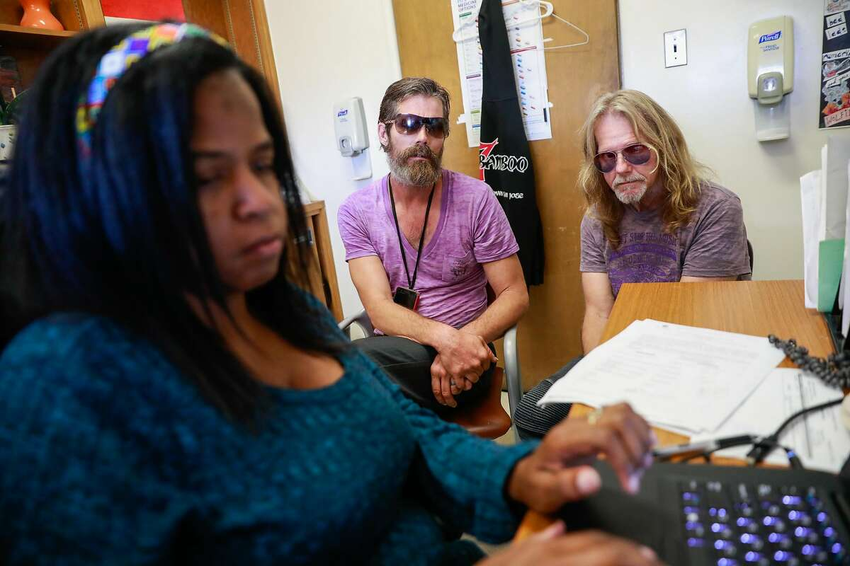 Social worker Kimberly Minter chats with Robert Fleischaur and partner Rickey Lee(l-r)during an appointment at Ward 86 at the Zuckerberg San Francisco Hospital in San Francisco, California, on Tuesday, Sept. 10, 2019. Robert and partner Rickey both have HIV.