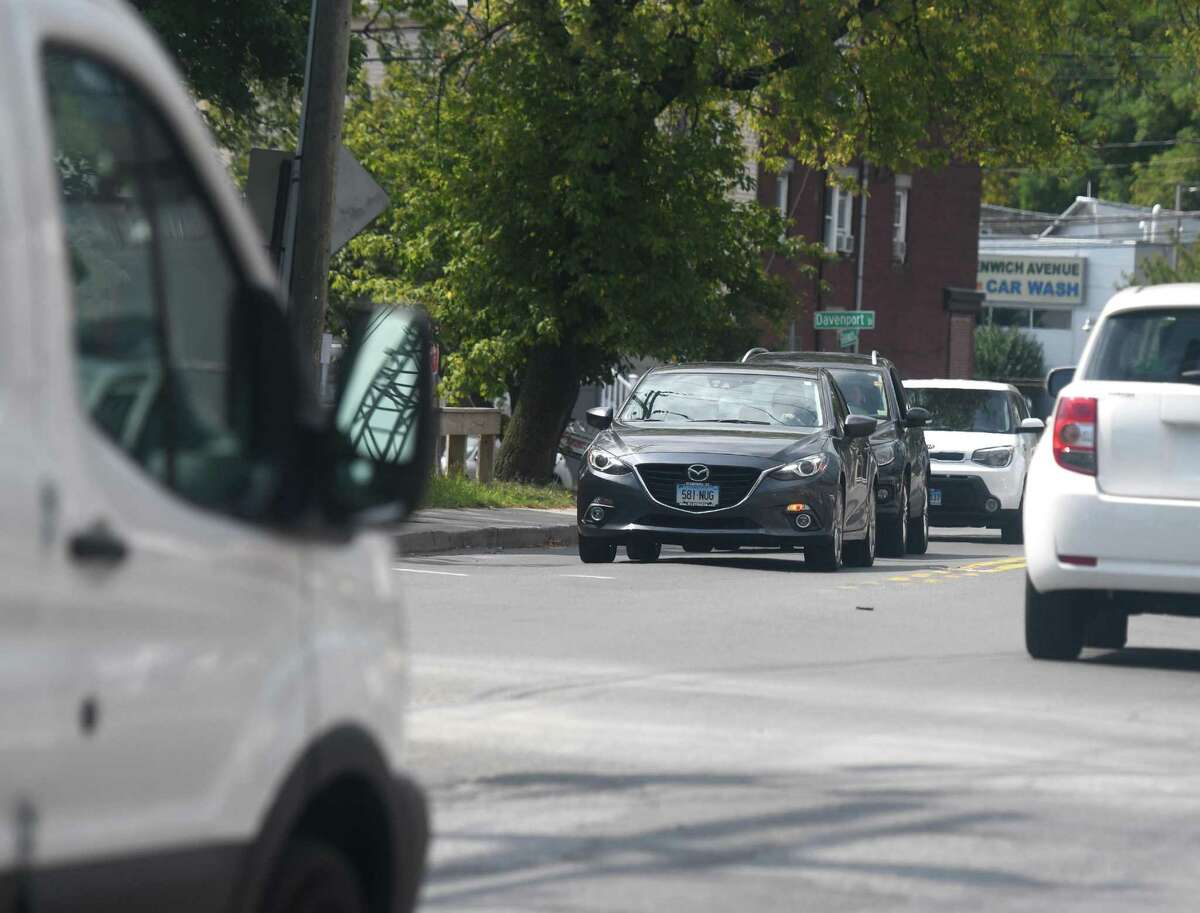 Traffic passes through the intersection of Greenwich Avenue and Pulaski Street in the Waterside section of Stamford, Conn. Monday, Sept. 9, 2019. The Stamford Transportation Bureau is looking to replace the stoplights with a modern roundabout at the intersection of Greenwich Avenue, Davenport Street and Pulaski Street.