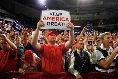 Supporters rally as President Donald Trump speaks at a campaign rally. The Harris County GOP says it has learned lessons over the last four years and made changes that will return them to the voters' favor, but dislike for President Trump is a difficult hurdle.