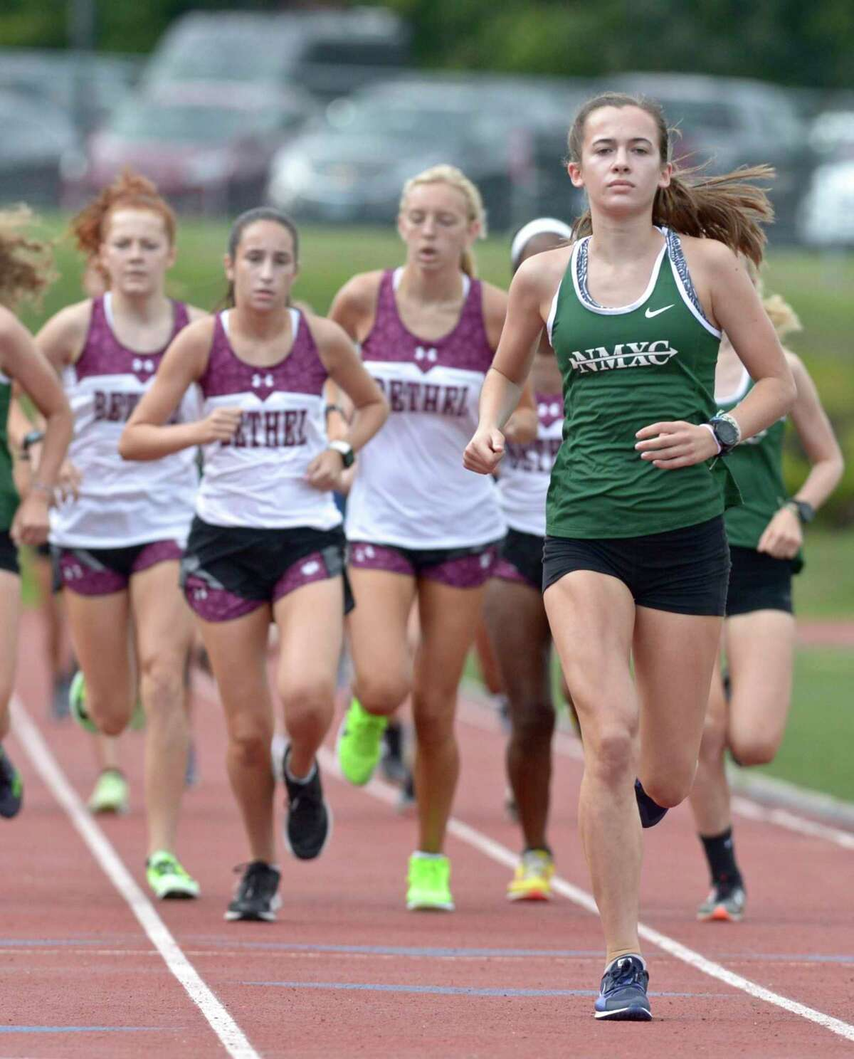 New Milford's Claire Daniels, right, finished first in a meet with Bethel and Brookfield earlier this season.