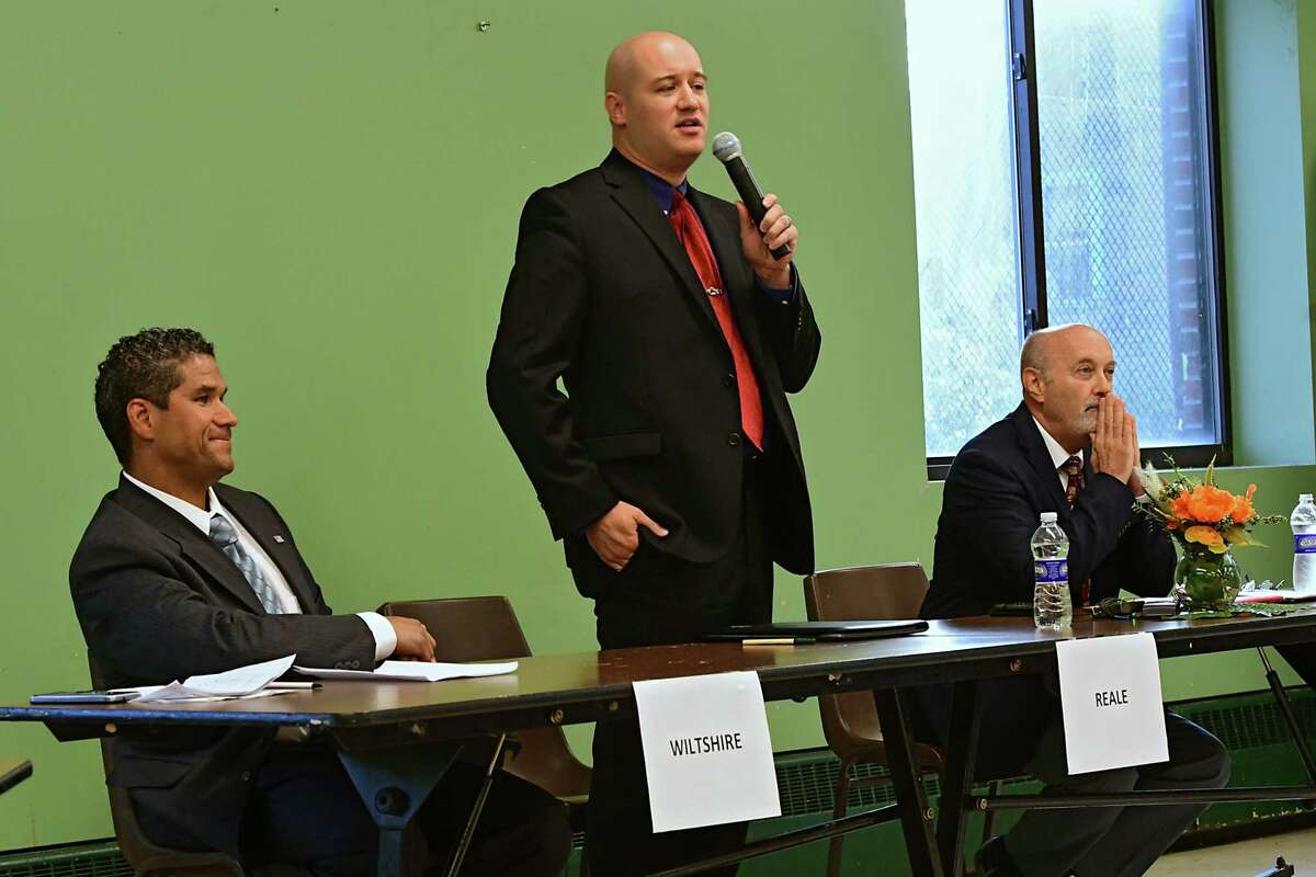 From left, Rodney Wiltshire, Tom Reale and Troy Mayor Patrick Madden participate in a debate held at the Lansingburgh Boys and Girls Club on Tuesday, Sept. 10, 2019 in Troy, N.Y. (Lori Van Buren/Times Union)