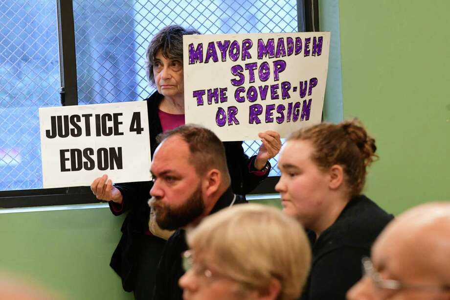 A woman holds sign as Rodney Wiltshire, Tom Reale and Troy Mayor Patrick Madden participate in a debate held at the Lansingburgh Boys and Girls Club on Tuesday, Sept. 10, 2019 in Troy, N.Y. (Lori Van Buren/Times Union) Photo: Lori Van Buren, Albany Times Union / 20047786A