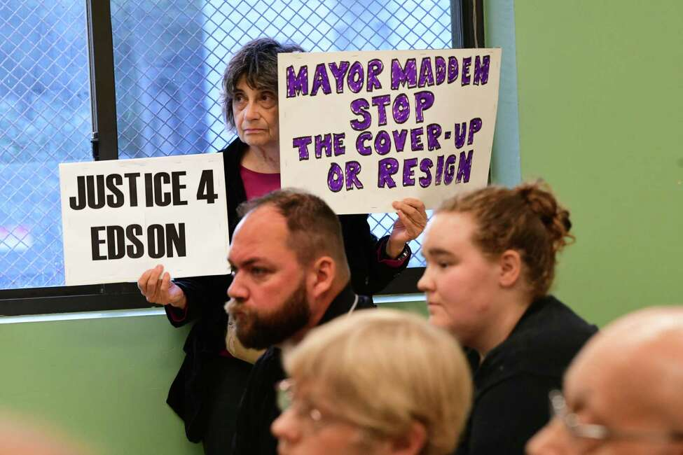 A woman holds sign as Rodney Wiltshire, Tom Reale and Troy Mayor Patrick Madden participate in a debate held at the Lansingburgh Boys and Girls Club on Tuesday, Sept. 10, 2019 in Troy, N.Y. (Lori Van Buren/Times Union)