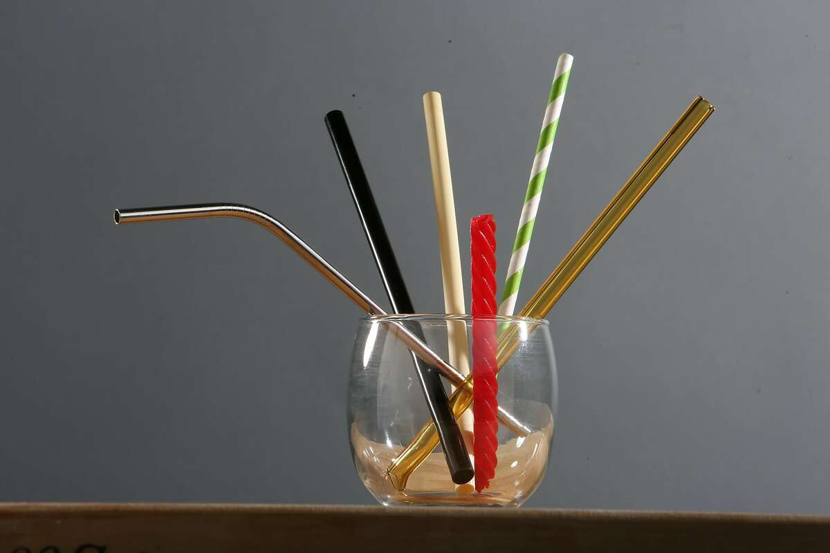 A stainless steel bent (l to r), stainless steel, Red Vine, hay, paper and glass straw are arranged in a glass on Wednesday, August 7, 2019 in San Francisco, Calif.