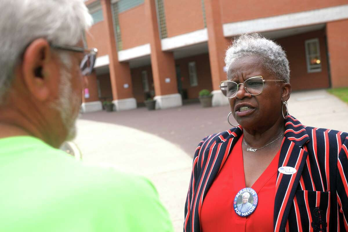 State Sen. Marilyn Moore, democratic candidate for Mayor in Bridgeport, greets voters turning out for Tuesday's primary elections in front of Luis Munoz Marin School, in Bridgeport, Conn. Sept. 10, 2019.