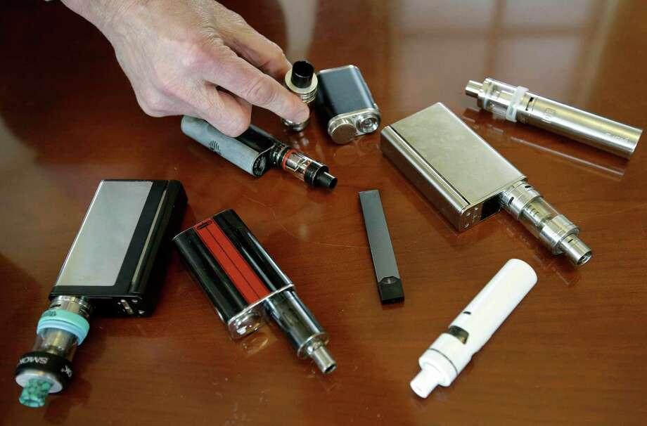 In this file photo, a Marshfield, Mass., high school principal displays vaping devices that were confiscated from students in such places as restrooms or hallways at the school. Photo: Steven Senne, STF / Associated Press / Copyright 2018 The Associated Press. All rights reserved.