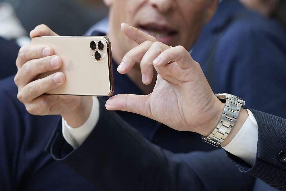 Apple team members demo the new cameras on iPhone 11 Pro for guests during an event to announce new products Tuesday, Sept. 10, 2019, in Cupertino, Calif. (AP Photo/Tony Avelar) Photo: Tony Avelar, Associated Press