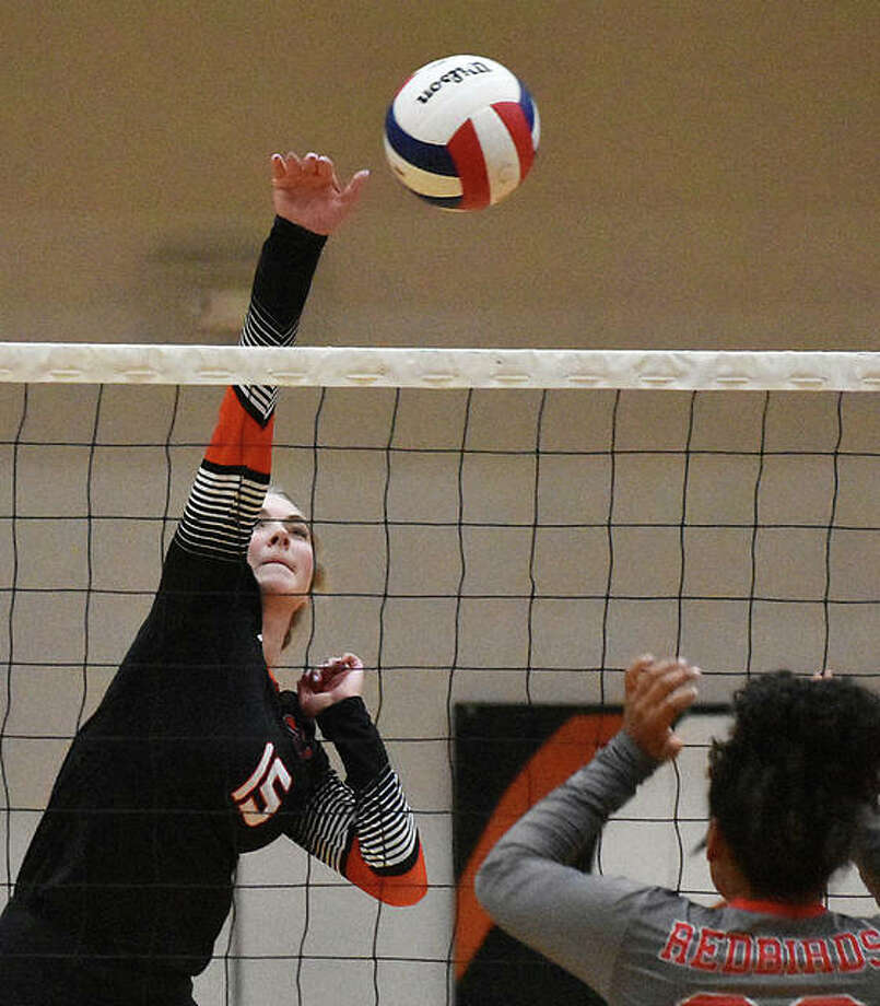 EHS hitter Lexie Curtis goes up for attack during the first set against Alton on Tuesday inside Lucco-Jackson Gymnasium. Photo: Matt Kamp|The Intelligencer