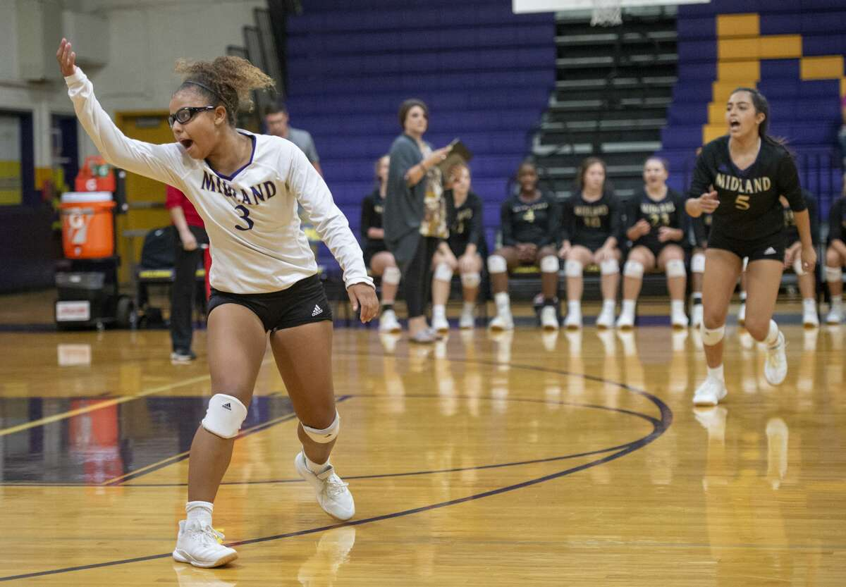 Midland High's Demmi Anders (3) and Alejandra Juarez (5) call as ball as out Tuesday, Sept. 10, 2019 at Midland High School.