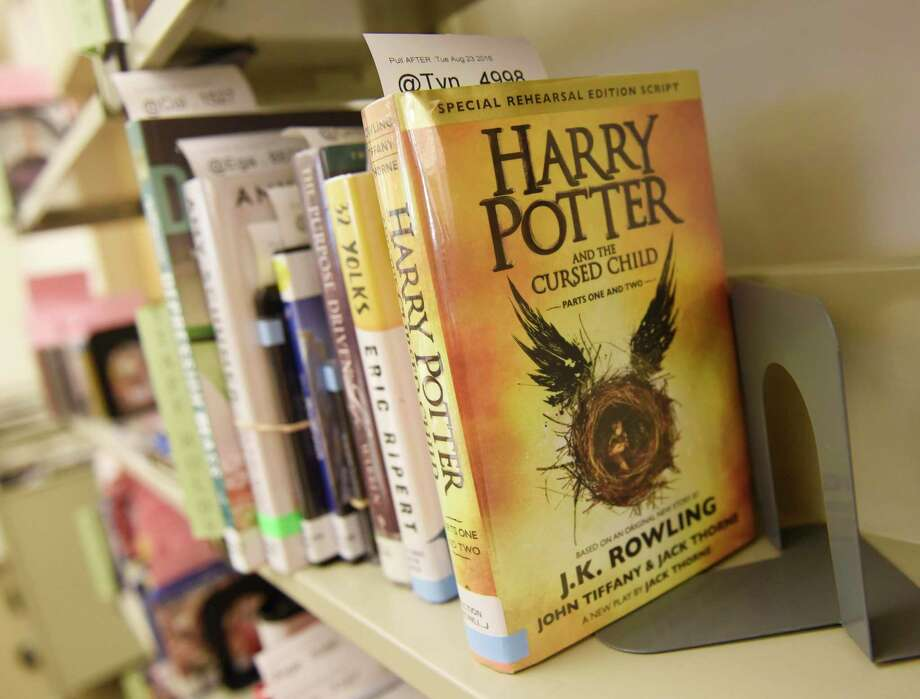 """Harry Potter and the Cursed Child,"" one of this summer's most popular books, sits on the returns shelf at Greenwich Library in Greenwich, Conn. Thursday, Aug. 18, 2016. Photo: Tyler Sizemore / Tyler Sizemore/Hearst Connecticut Media / Greenwich Time"