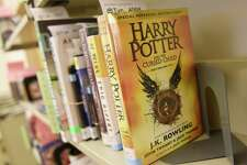 """""""Harry Potter and the Cursed Child,"""" one of this summer's most popular books, sits on the returns shelf at Greenwich Library in Greenwich, Conn. Thursday, Aug. 18, 2016."""