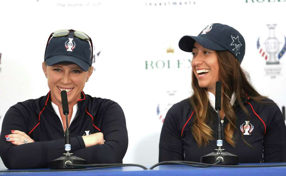 US Solheim cup players Morgan Pressel, left, Marina Alex during a press conference at Gleneagles, Auchterarder, Scotland, Tuesday, Sept. 10, 2019. The Solheim cup runs from 13-15 Sept. (AP Photo/Peter Morrison)