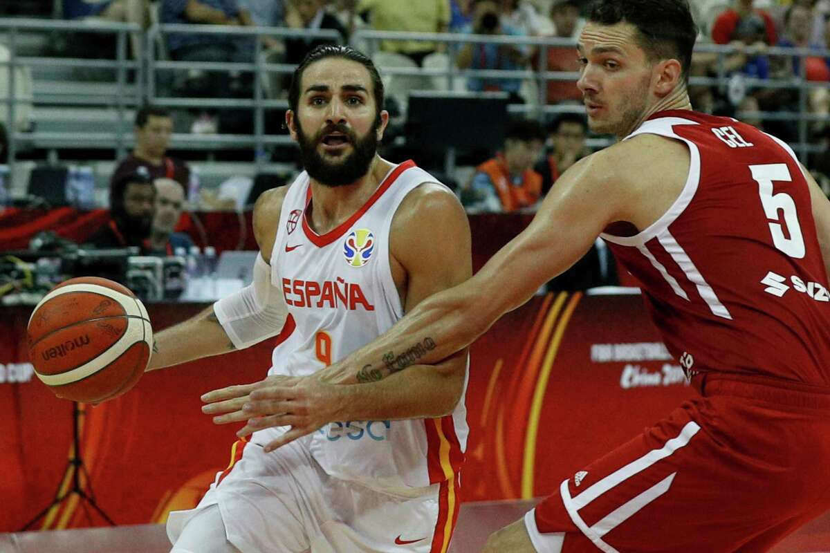 Ricky Rubio of Spain tries to get past Aaron Cel of Poland during their quarterfinals match for the FIBA Basketball World Cup, at the Shanghai Oriental Sports Center in Shanghai, Tuesday, Sept. 10, 2019. (AP Photo/Andy Wong)