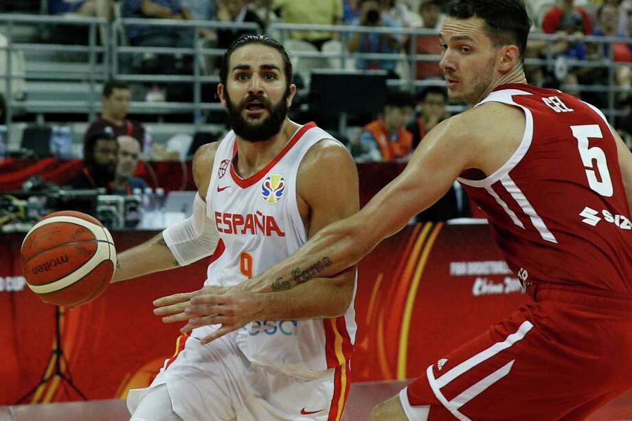 Ricky Rubio of Spain tries to get past Aaron Cel of Poland during their quarterfinals match for the FIBA Basketball World Cup, at the Shanghai Oriental Sports Center in Shanghai, Tuesday, Sept. 10, 2019. (AP Photo/Andy Wong) Photo: Andy Wong / Copyright 2019 The Associated Press. All rights reserved