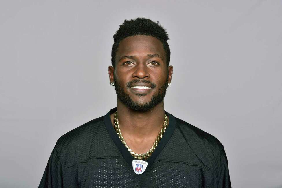 FILE - This is a June 18, 2018, file photo showing Antonio Brown of the Pittsburgh Steelers NFL football team. Steelers wide receiver Antonio Brown has ended his lengthy standoff with the team by meeting with president Art Rooney II, though any shot at reconciliation between the two sides appears to be out of the question. Brown, who has asked to be traded, posted a picture on various social media accounts on Tuesday, Feb. 19, 2019, that showed him arm in arm with Rooney at the Palm Beach International Airport. (AP Photo/File)
