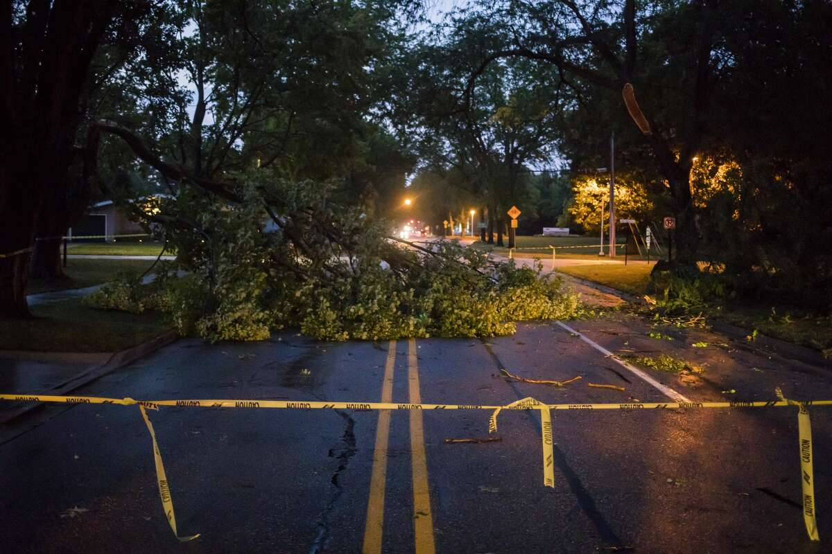 Swede Avenue is blocked off by caution tape near Haley Street after a tree fell and blocked the road during a thunderstorm Tuesday, Sept. 10, 2019 in Midland. (Katy Kildee/kkildee@mdn.net)