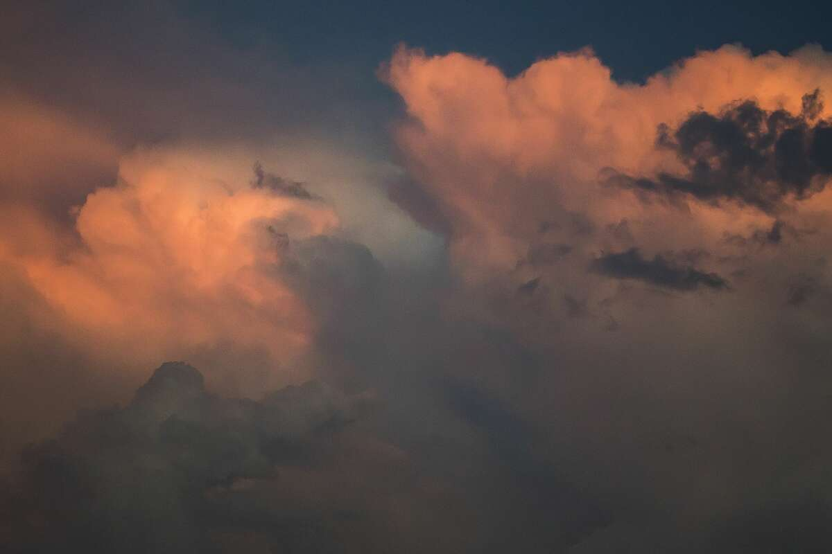 Storm clouds are illuminated by sunlight as the sun begins to set Tuesday, Sept. 10, 2019 in Midland. (Katy Kildee/kkildee@mdn.net)