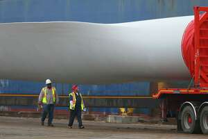 Giant wind turbine blades are offloaded from a freighter Friday January 20, 2017 at the Port of Corpus Christi. Parts for wind turbines that are being erected in the United States come from countries across the globe such as Spain and Brazil. These blades are 63 meters long and are made of carbon fiber. The Port of Corpus Christi started receiving wind energy cargo in 2006.