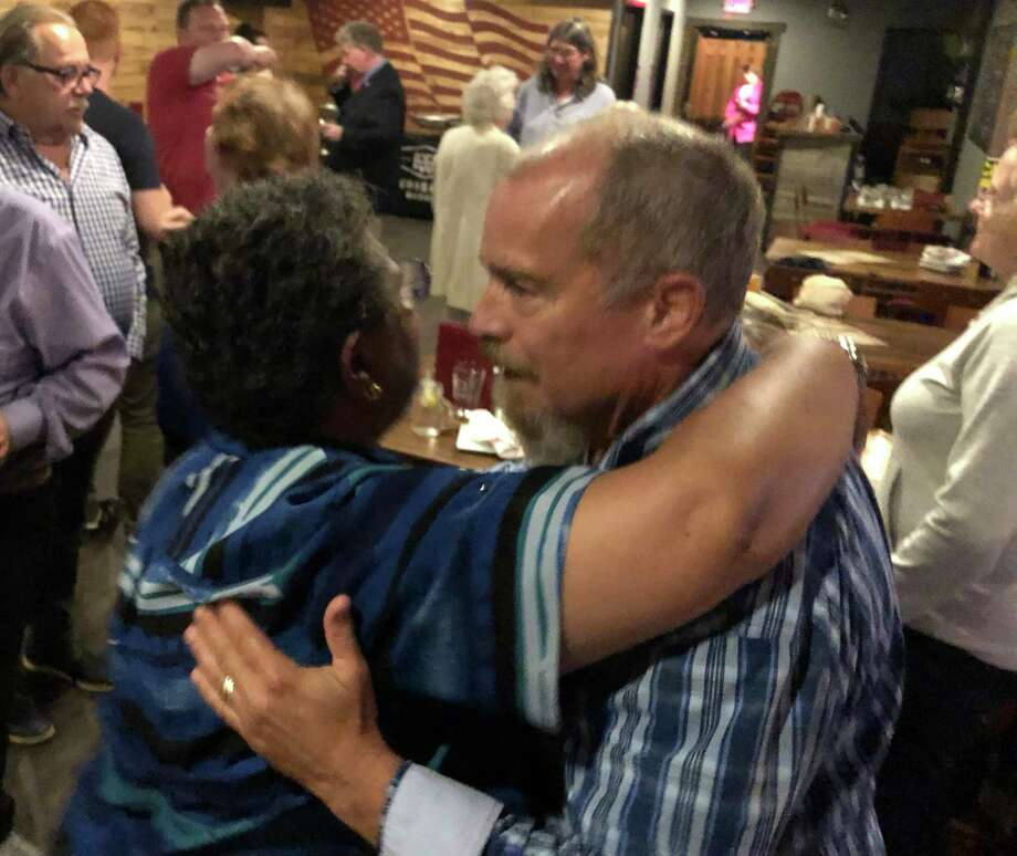 Stephanie Philips, left, the chair of Stratford's Democratic Town Committee congratulates Town Council Member Greg Cann Sept. 10, 2019 at the Whiskey Barrel after Cann won a primary against challenger Allison Longo-Taccogna. Photo: Ethan Fry / Hearst Connecticut Media