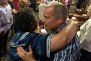 Stephanie Philips, left, the chair of Stratford's Democratic Town Committee congratulates Town Council Member Greg Cann Sept. 10, 2019 at the Whiskey Barrel after Cann won a primary against challenger Allison Longo-Taccogna.