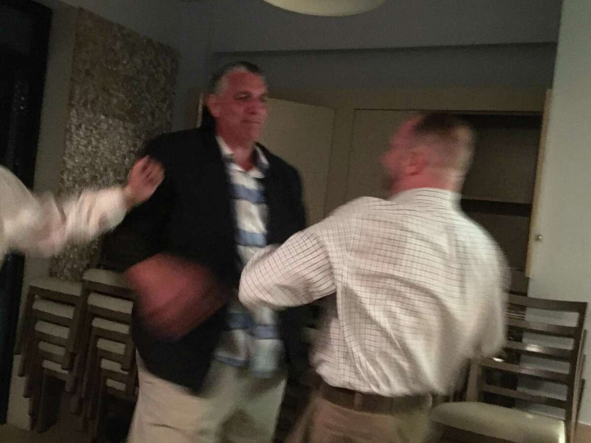 """East Haven Republican mayoral candidate """"Big Steve"""" Tracey is congratulated by retired police detective and new Town Council member Robert Ranfone after their victory in a primary Tuesday night, Sept. 10, 2019."""
