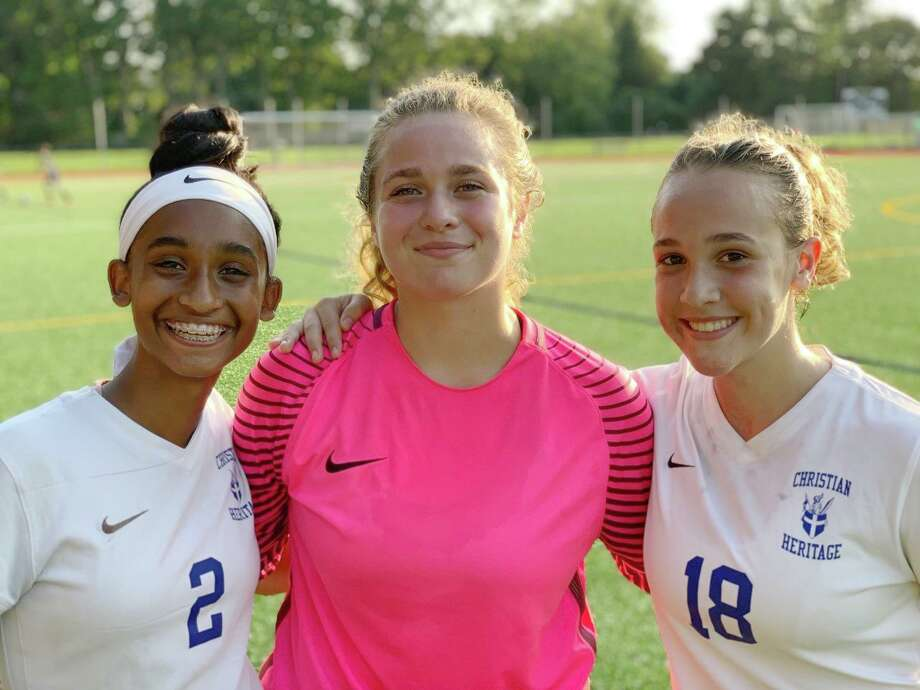 Natania Muriel, Ainiah Perretta and Sarah Ramadanovic helped CHS win its second consecutive game to start the season. Photo: Contributed Photo / Christian Heritage Athletics / Trumbull Times