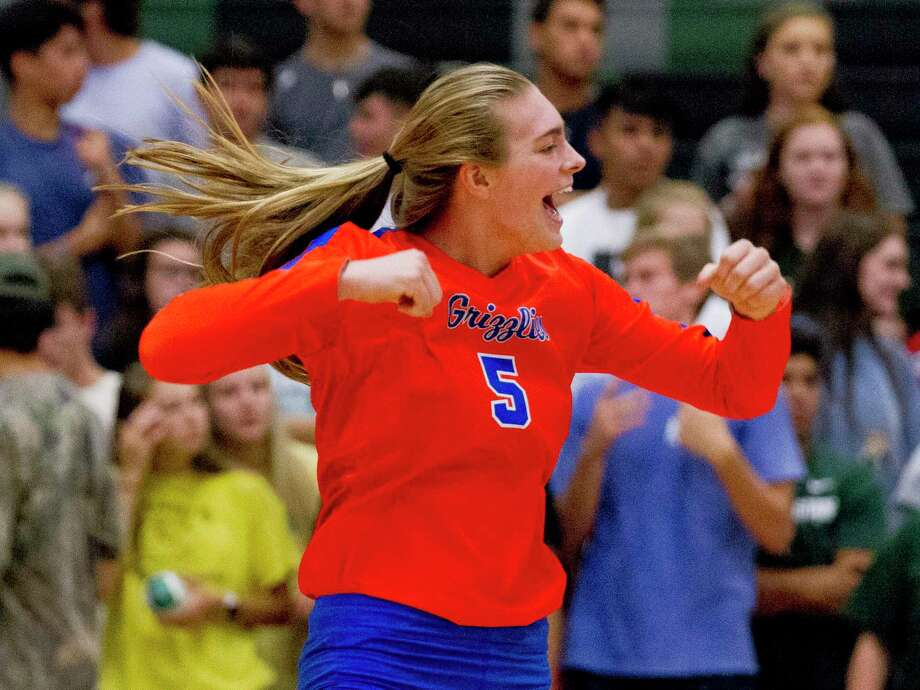 Grand Oaks middle blocker Kamie Lohnes (5) reacts after scoring a point during the first set of a District 20-5A high school volleyball match at Kingwood Park High School, Tuesday, Sept. 10, 2019, in Kingwood. Photo: Jason Fochtman, Houston Chronicle / Staff Photographer / Houston Chronicle