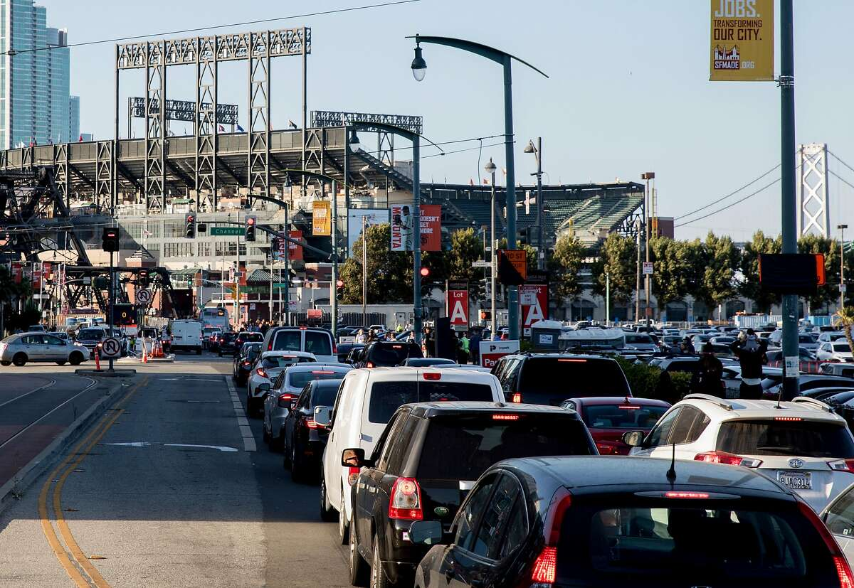 Cars are seen in stopped traffic along 3rd Street as they attempt to park in Lot A near Oracle Park and Chase Center for dueling events in San Francisco, Calif. Tuesday, September 10, 2019.