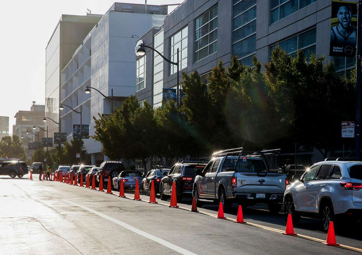 Cars line up along Warriors Way to park outside of Chase Center in San Francisco, Calif. Tuesday, September 10, 2019.