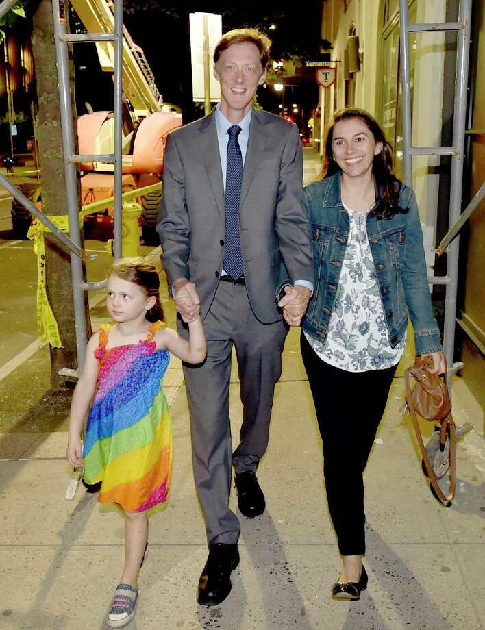New Haven Democratic Primary mayoral candidate Justin Elicker Tuesday night claiming victory walks to his victory party at the Trinity Bar & Grill in New Haven with his wife Natalie and daughter Molly, 4, after defeating incumbent Mayor Toni Harp in the New Haven Democratic Primary. Photo: Peter Hvizdak / Hearst Connecticut Media / New Haven Register