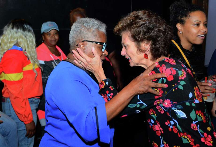 Supporter Donna Curran, of Bridgeport, right, consoles State Senator Marilyn Moore, left, after Moore unofficially lost her primary challenge against Mayor Joe Ganim during her campaign party at the Bijou Theater in Bridgeport, Conn., on Tuesday Sept. 10, 2019. Absentee ballots are holding up the final results. Photo: Christian Abraham / Hearst Connecticut Media / Connecticut Post