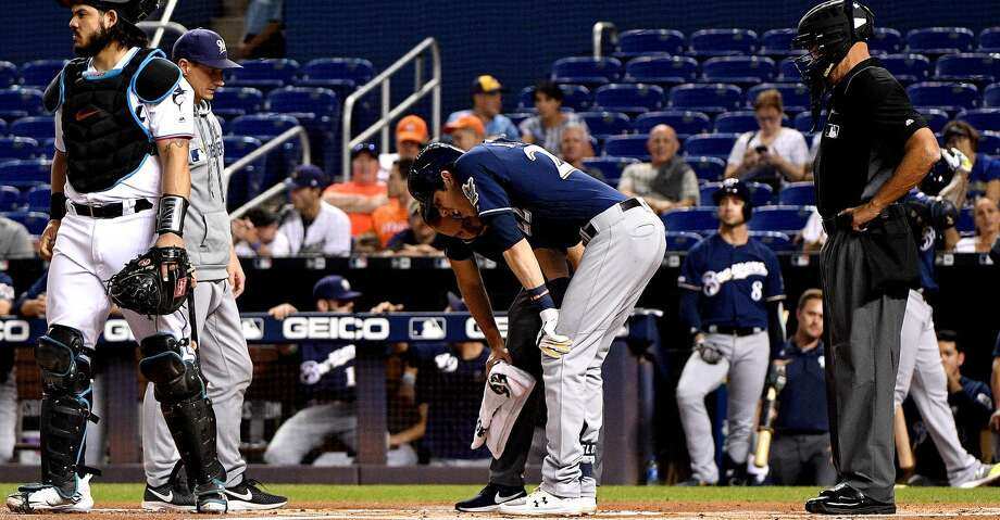 MIAMI, FLORIDA - SEPTEMBER 10: Christian Yelich #22 of the Milwaukee Brewers is checked out by the medical staff after an injury from ball deflection in the first inning against the Miami Marlins at Marlins Park on September 10, 2019 in Miami, Florida. (Photo by Mark Brown/Getty Images) Photo: Mark Brown/Getty Images