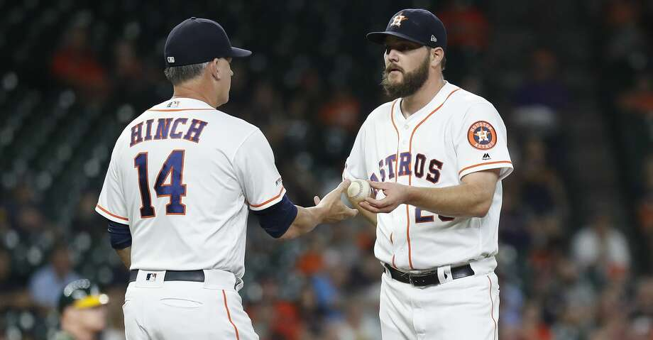 Houston Astros starting pitcher Wade Miley (20) gets pulled by manager AJ Hinch during the first inning of a MLB baseball game at Minute Maid Park, Tuesday, Sept. 10, 2019, in Houston. Photo: Karen Warren/Staff Photographer