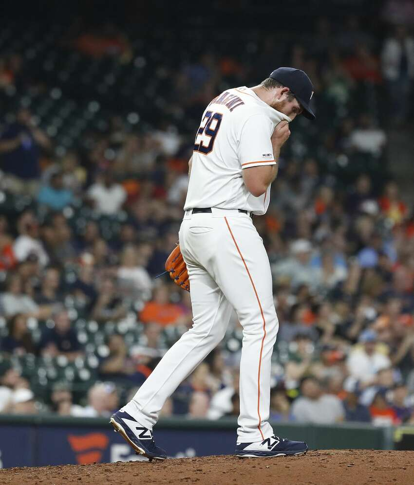 Houston Astros relief pitcher Joe Biagini (29) reacts after giving up a two-run home run to Oakland Athletics Marcus Semien during the fourth inning of a MLB baseball game at Minute Maid Park, Tuesday, Sept. 10, 2019, in Houston.