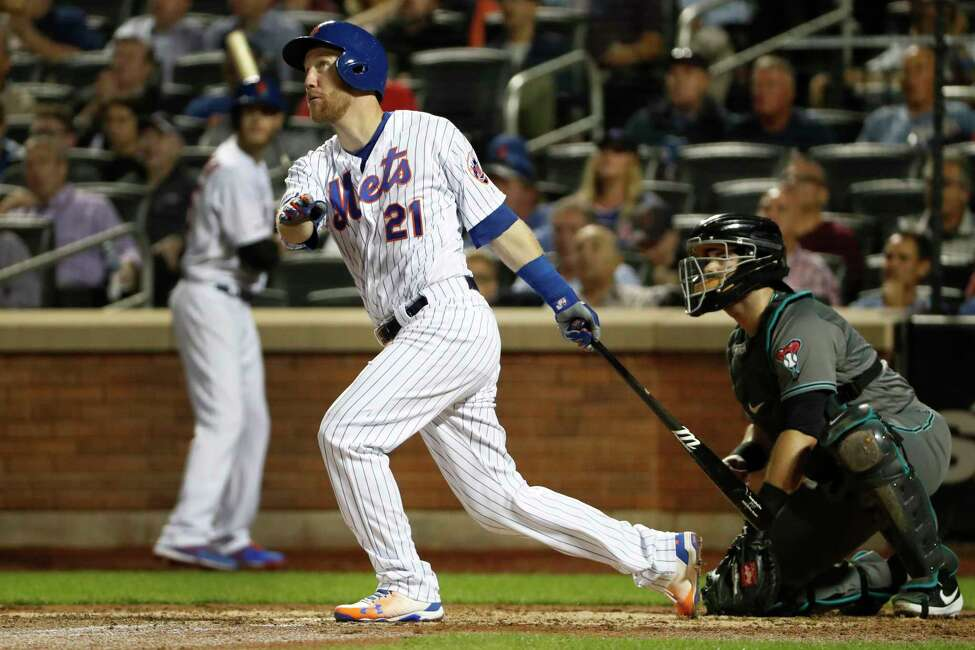 New York Mets' Todd Frazier watches his fourth-inning RBI double in a baseball game against the Arizona Diamondbacks, Tuesday, Sept. 10, 2019, in New York. It was Frazier's second double of the game. Diamondbacks catcher Alex Avila is behind the plate. (AP Photo/Kathy Willens)