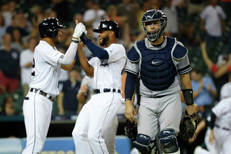New York Yankees catcher Gary Sanchez walks to the dugout as the Detroit Tigers celebrate a Jordy Mercer single to score Willi Castro in the ninth inning of a baseball game against the New York Yankees in Detroit, Tuesday, Sept. 10, 2019. Detroit won 12-11. (AP Photo/Paul Sancya)