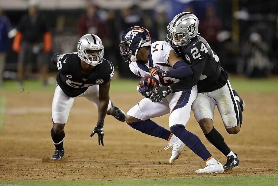 Denver Broncos wide receiver Courtland Sutton is brought down by Oakland Raiders defensive back Johnathan Abram (24) during the second half of an NFL football game Monday, Sept. 9, 2019, in Oakland, Calif. At left is Raiders outside linebacker Tahir Whitehead. (AP Photo/Ben Margot) Photo: Ben Margot / Associated Press